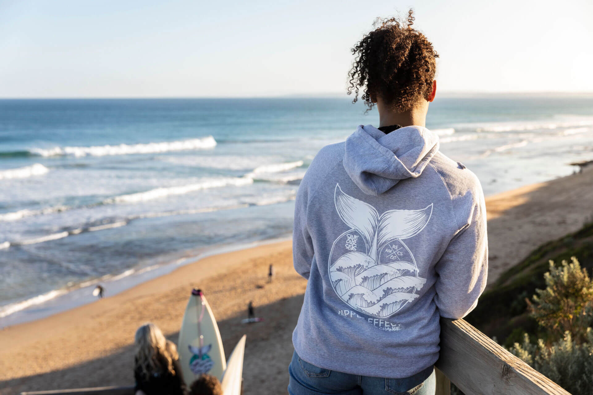 RIPPLE EFFECT the change-grey-mens-hoody overlooking beach
